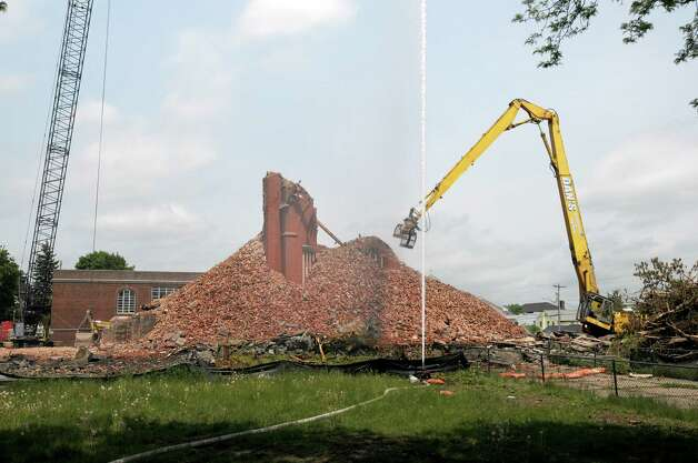 Crews pick apart the bricks as the demolition of the former St. Patrick's Church continued on Monday, May 20, 2013 in Watervliet, NY.   (Paul Buckowski / Times Union) Photo: Paul Buckowski