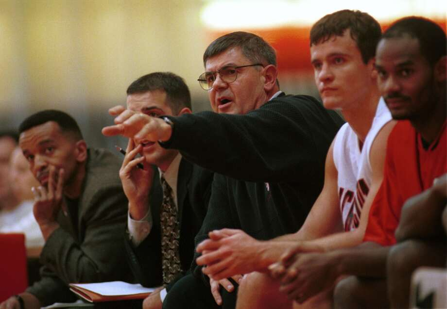Fairfield_110999_ Sacred Heart University Mens basketball head coach, Dave Bike coaching his team in game against the Connecticut Stars. Mark Conrad/Staff Photo