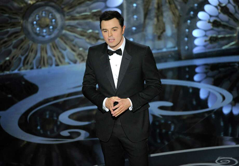 FILE - In this Feb. 24, 2013 file photo, host Seth MacFarlane speaks onstage during the Oscars at the Dolby Theatre in Los Angeles. MacFarlane is too busy to host the Oscars in 2014. He announced the news on Twitter Monday, May 20, 2013.  (Photo by Chris Pizzello/Invision/AP, File) Photo: Chris Pizzello