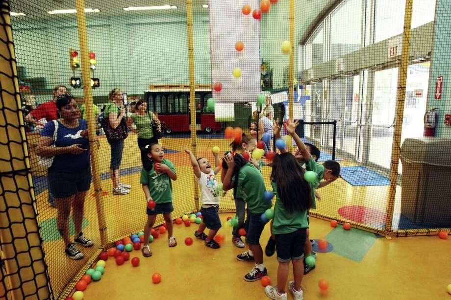 Kids explore the San Antonio Children's Museum at 305 E. Houston St. Photo: Express-News File Photo