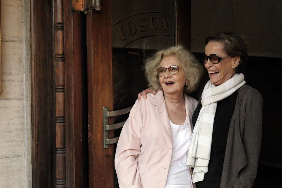 Jeannette Etheredge, owner of Tosca, gets a hug from her longtime best friend, Gina Moscone, widow of the former mayor.