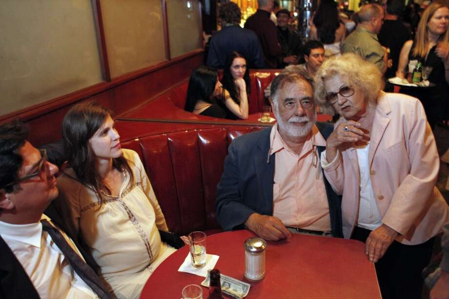 Jeannette Etheredge, owner of Tosca, sits with Francis Ford Coppola, Jennifer Furches, and Roman Coppola (right to left) at the famed San Francisco bar late Sunday. T