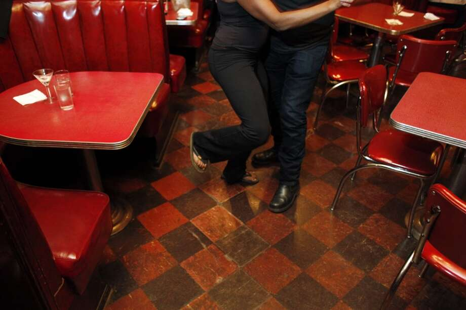 Dancing, and the tile floor, and the red booths.