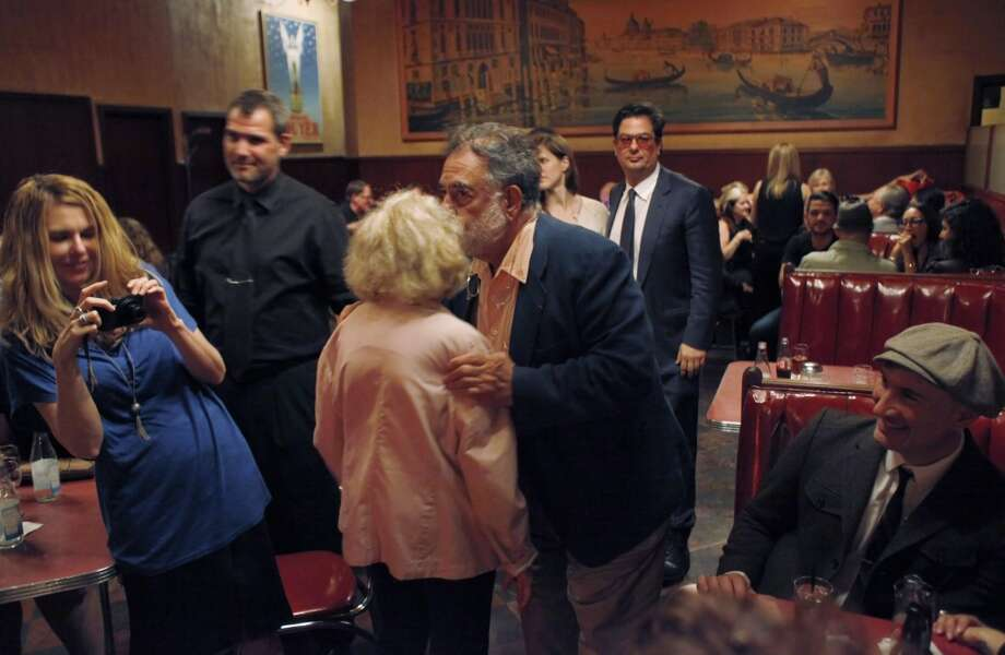 Francis Ford Coppola gives a kiss on the cheek as he bids farewell to Jeannette Etheredge.