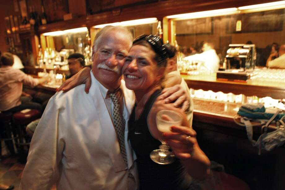 Steve Williamson, left, poses with Amy B. who was the last customer to get a famed House Capuccino drink served at this incarnation of Tosca Cafe.
