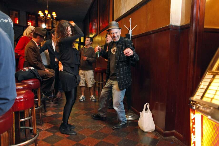 Jack Yaghugian dances with Laura Carrera of Rome at Tosca Cafe.