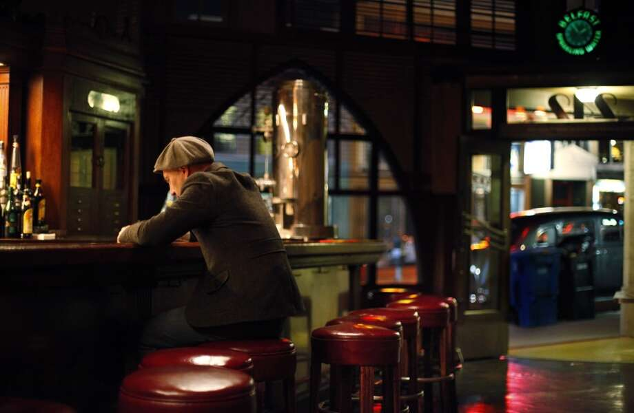 Joe Rosato, Jr., sits alone at the bar at Tosca Cafe just minutes before the famed San Francisco watering hole shut its doors for a major renovation in the early hours Monday.