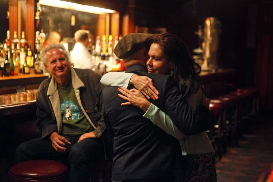 Holly Hampton hugs Al Ribaya as Tosca Cafe closes for the last time in the early morning hours Monday.