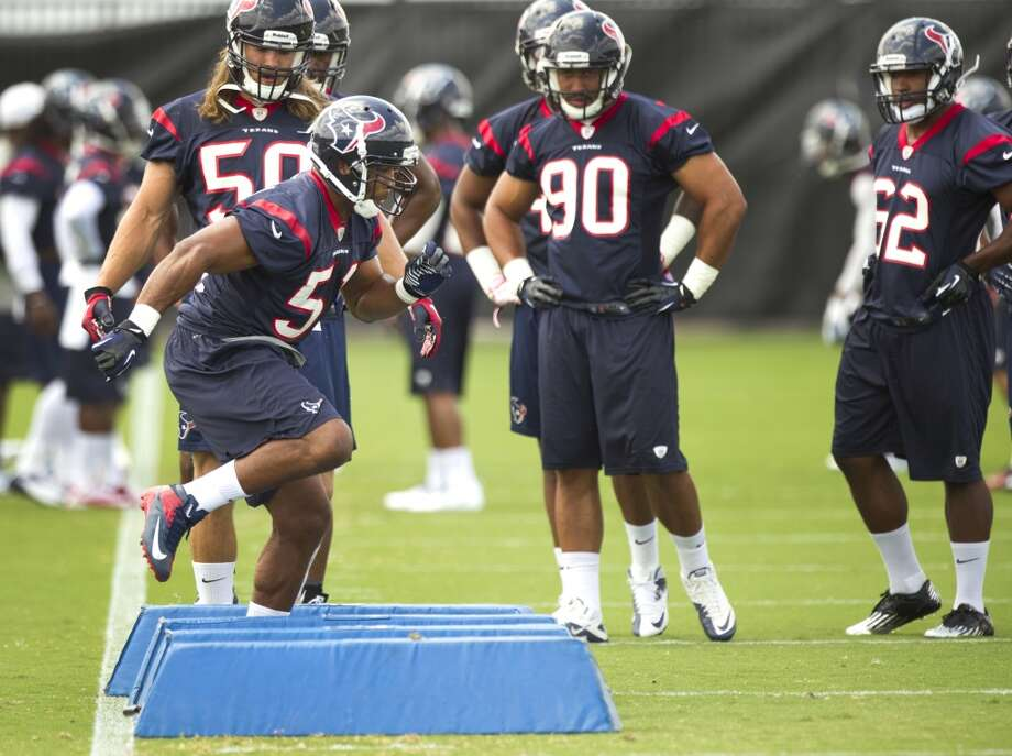 Texans linebacker Darryl Sharpton (51) runs a drill.