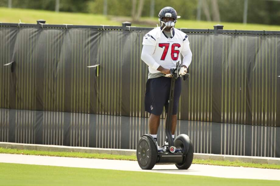 Texans tackle Duane Brown ride a Segway to practice.