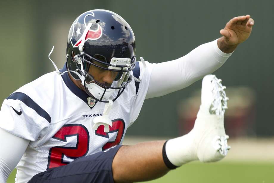 Texans running back Arian Foster stretches at the beginning of practice.