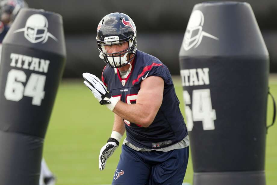 Texans linebacker Brooks Reed runs through blocking dummies.