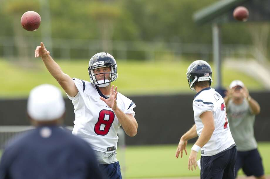 Texans quarterbacks Matt Schaub (8) and Case Keenum (7) throw passes.