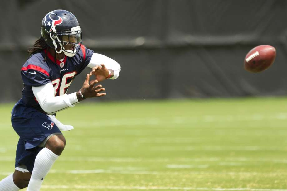 Texans safety D.J. Swearinger reaches out to make a catch during a drill.