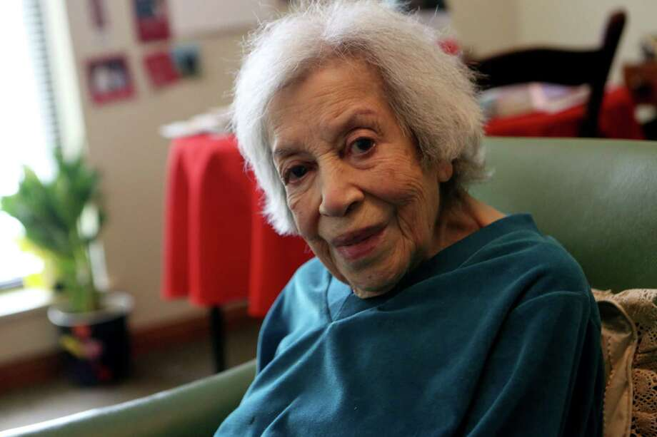 Raquel Mathis of San Antonio is one of an estimated 450,000 centenarians worldwide. It is a fast-growing population, one that is pointing to a lack of geriatric specialists. Photo: Photos By Helen L. Montoya / San Antonio Express-News