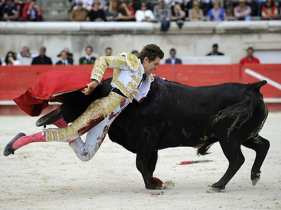 TOPSHOTS French Matador Juan Leal is gored by a bull on May 19, 2013 during during the Nimes Pentecost Feria in Nimes, southern France. AFP PHOTO / PASCAL GUYOTPASCAL GUYOT/AFP/Getty Images Photo: Pascal Guyot, AFP/Getty Images