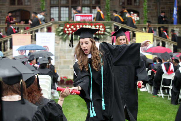 Courtney Winger interacts with a seated classmate after receiving her diploma during Fairfield University's 63rd Commencement ceremony on the Fairfield, Conn. campus on Sunday, May 19, 2013. Photo: BK Angeletti, B.K. Angeletti / Connecticut Post freelance B.K. Angeletti