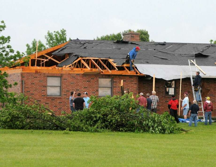 Damage is shown to a rooftop home in Oklahoma.