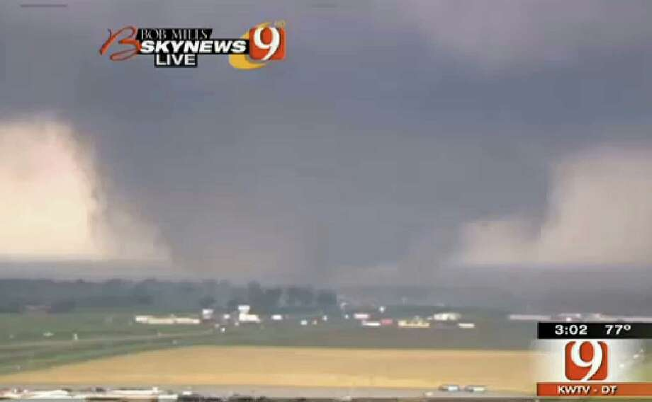 This frame grab provided by KWTV shows a tornato in Oklahoma City Monday, April 20, 2013. Television footage shows flattened buildings and fires after a mile-wide tornado moved through the Oklahoma City area. (AP Photo/Courtesy KWTV) Photo: Associated Press / KWTV Oklahoma City