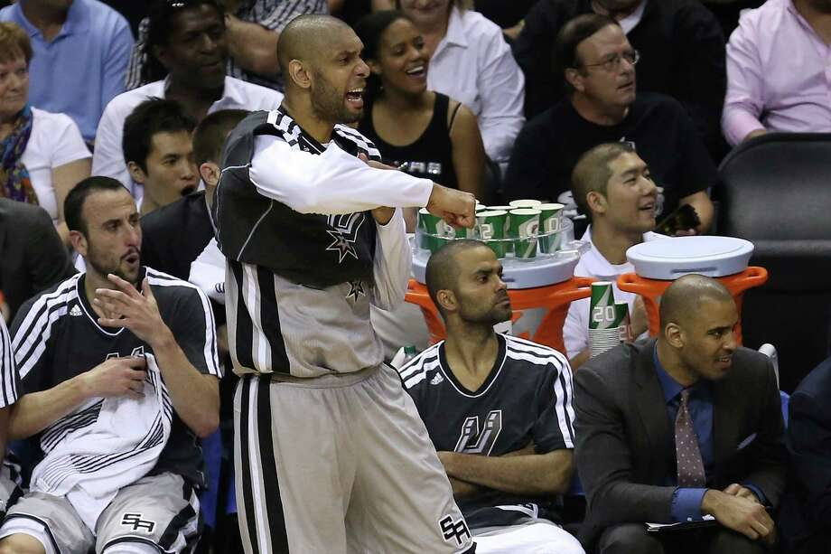 Tim Duncan had six points and two blocks Sunday when he wasn't cheering with Manu Ginobili and Tony Parker.  Stephen Dunn / Getty Images Photo: Stephen Dunn, Getty Images / 2013 Getty Images