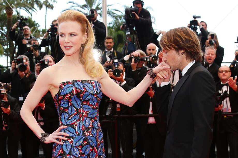 CANNES, FRANCE - MAY 19: Keith Urban kisses the hand of jury member Nicole Kidman as they attend the 'Inside Llewyn Davis' Premiere during the 66th Annual Cannes Film Festival at Palais des Festivals on May 19, 2013 in Cannes, France.  (Photo by Vittorio Zunino Celotto/Getty Images)