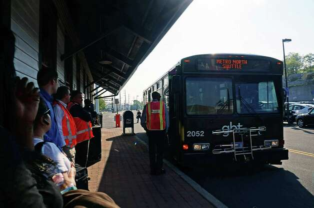Passengers at the downtown train station wait to find out if this shuttle bus is heading to Westport or the Fairfield Metro station. Photo: Genevieve Reilly / Fairfield Citizen
