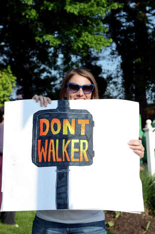 "Lindsay Farrell, of New Haven, holds a ""Don't Walker"" sign in protest of the Prescott Bush Awards dinner keynote speaker Wisonsin Gov. Scott Walker across the street from the entrance to the Stamford Hilton Hotel in Stamford on Monday, May 20, 2013. Photo: Amy Mortensen / Connecticut Post Freelance"