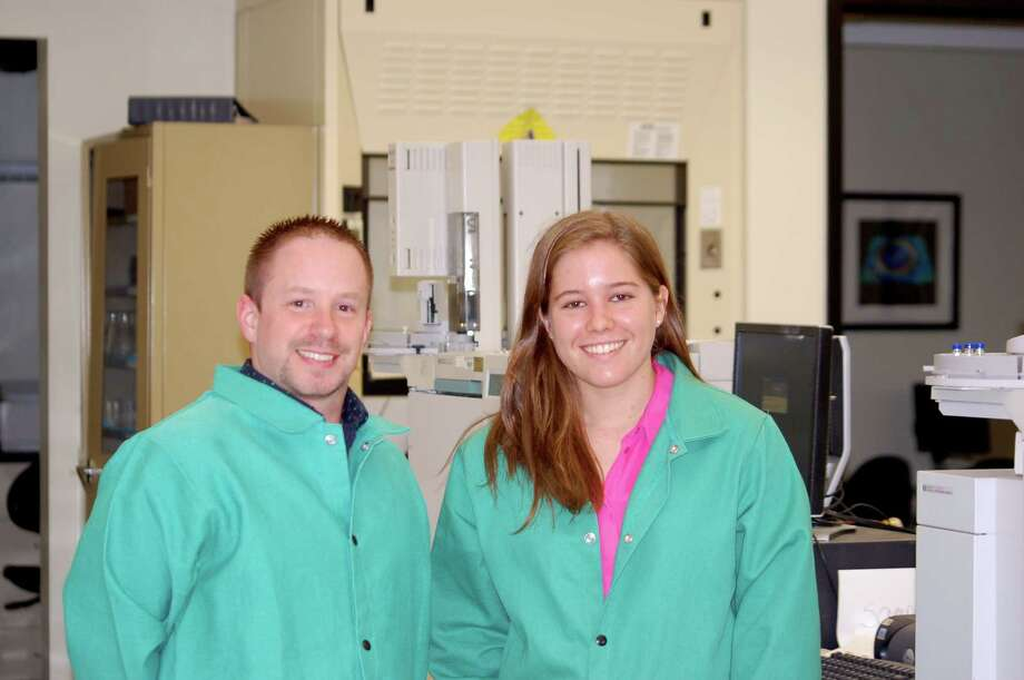 University at Albany students Jason Seeley (left) and Clare Miller created a proof-of-concept solar cell composed of peptides, or chains of amino acids.
