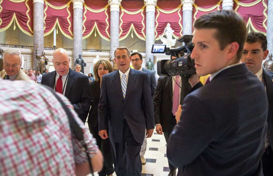 House Speaker John Boehner walks through the Capitol after scuttling a immigration spending measure, in Washington, July 31, 2014. In conceding that the emergency bill would be rejected by the GOP's most conservative members, Boehner ensured that Congress would head home for a recess without enacting legislation to address the crisis at the border. Photo: DOUG MILLS, New York Times / NYTNS