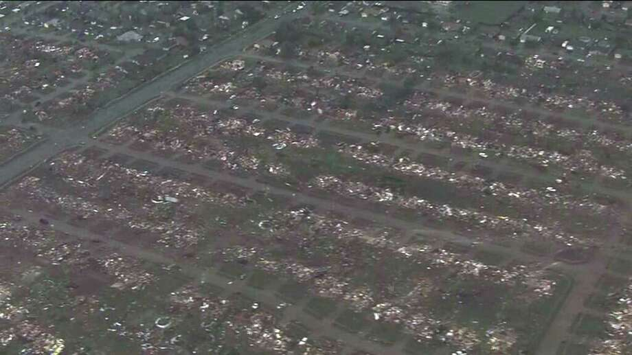 This photo provided by KFOR-TV shows homes flattened outside Moore, Okla., Monday, May 20, 2013. A monstrous tornado as much as a mile wide roared through the Oklahoma City suburbs Monday, flattening entire neighborhoods, setting buildings on fire and landing a direct blow on an elementary school. (AP Photo/KFOR-TV) MANDATORY CREDIT Photo: KFOR-TV, Associated Press / AP