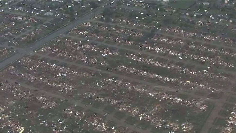 This photo provided by KFOR-TV shows homes flattened outside Moore, Okla., Monday, May 20, 2013. A monstrous tornado as much as a mile wide roared through the Oklahoma City suburbs Monday, flattening entire neighborhoods, setting buildings on fire and landing a direct blow on an elementary school. (AP Photo/KFOR-TV) MANDATORY CREDIT Photo: Kfor-tv, Associated Press
