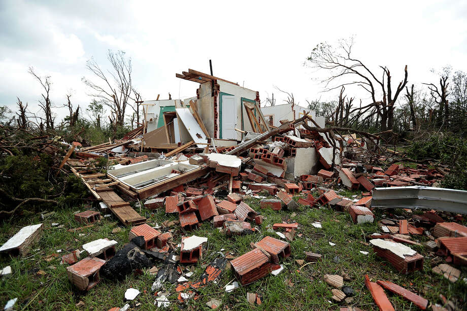 A home sits damaged after a tornado moved through the area May 20, 2013 near Shawnee, Oklahoma. A series of tornados moved across central Oklahoma May 19, killing two people and injuring at least 21. Photo: Brett Deering, Getty Images / 2013 Getty Images