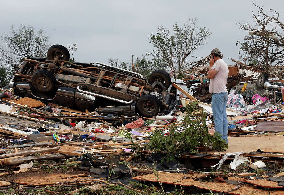 John Warner surveys the damage near a friend's mobile home in the Steelman Estates Mobile Home Park, destroyed in Sunday's tornado, near Shawnee, Okla., Monday, May 20, 2013. Photo: Sue Ogrocki, ASSOCIATED PRESS / AP2013