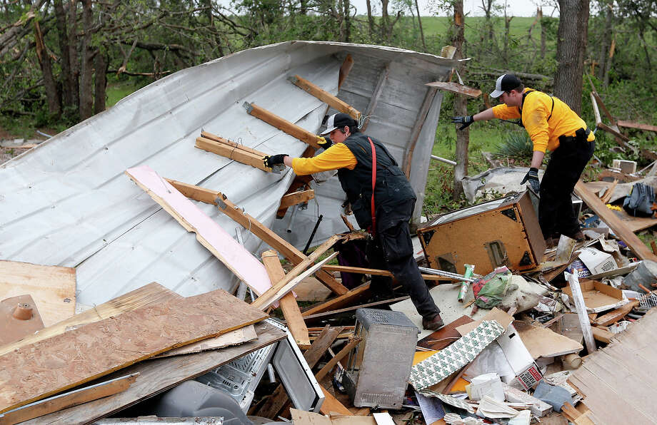 Members of the Chickasaw Nation search and rescue group dig through debris, Monday, May 20, 2013, to locate a kitten buried in the rubble of a mobile home destroyed in Sunday's tornado, in the Steelman Estates Mobile Home Park, near Shawnee, Okla. Photo: Sue Ogrocki, ASSOCIATED PRESS / AP2013