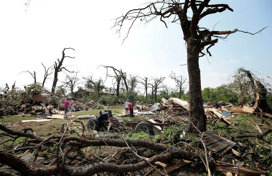Volunteers help with cleanup of Tom and Ronda Clark's property after it was damaged by a tornado May 20, 2013 near Shawnee, Oklahoma. A series of tornados moved across central Oklahoma May 19, killing two people and injuring at least 21. Photo: Brett Deering, Getty Images / 2013 Getty Images