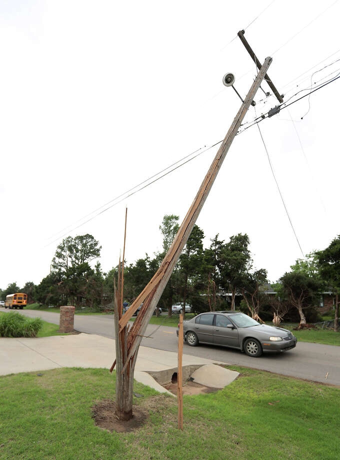 A power line pole bent by a tornado stands over a street May 20, 2013 near Shawnee, Oklahoma. A series of tornados moved across central Oklahoma May 19, killing two people and injuring at least 21. Photo: Brett Deering, Getty Images / 2013 Getty Images