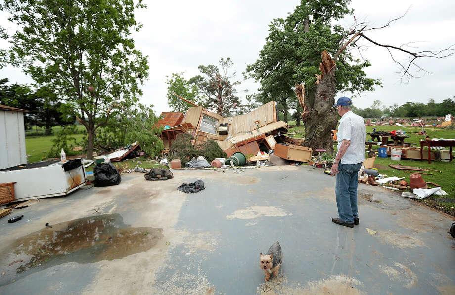 Lonnie Langston stands near his garage that was swept off the concrete pad next to his house by a tornado May 20, 2013 near Shawnee, Oklahoma. A series of tornados moved across central Oklahoma May 19, killing two people and injuring at least 21. Photo: Brett Deering, Getty Images / 2013 Getty Images