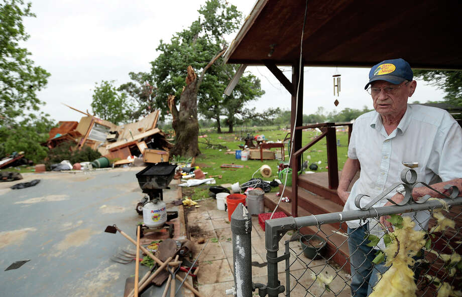 Lonnie Langston talks about his garage that was swept off the concrete pad next to his house by a tornado May 20, 2013 near Shawnee, Oklahoma. A series of tornados moved across central Oklahoma May 19, killing two people and injuring at least 21. Photo: Brett Deering, Getty Images / 2013 Getty Images