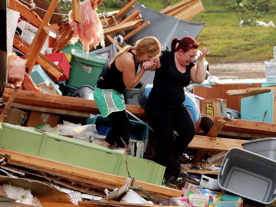 Alli Christian, left, helps Jessica Wilkinson as she looks for her dog Bella after Wilkinson returned to find her home near 156th street and Franklin Road destroyed by a tornado, Sunday, May 19, 2013, in Norman, Okla. Photo: Steve Sisney, ASSOCIATED PRESS / AP2013