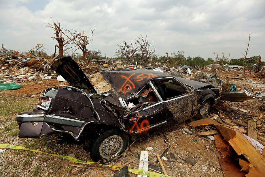 A smashed car sits in a debris field in the Rancho Brazos subdivision Sunday, May 19, 2013 in Granbury, Texas. Residents in the neighborhood continued cleanup of their damaged homes after a May 15 tornado wreaked havoc on the area, injuring dozens and killing six people. Photo: G.J. McCarthy, ASSOCIATED PRESS / THE DALLAS MORNING NEWS2013