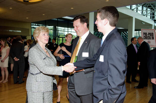 Linda McMahon greets Steven Kolenberg, of Stamford, and his father Bob Kolenberg, during the annual Connecticut GOP Prescott Bush Awards dinner at the Stamford Hilton Hotel in Stamford on Monday, May 20, 2013. Photo: Amy Mortensen / Connecticut Post Freelance