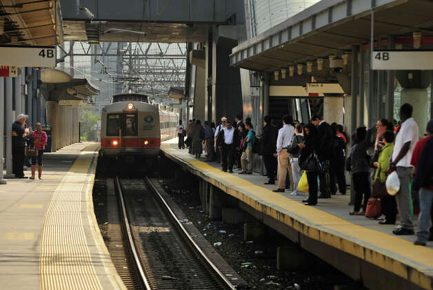 Commuters wait for the South Norwalk-bound train to arrive at the Metro-North station in Stamford on Monday, May 20, 2013. Because of the train derailment in Bridgeport, many travelers were finding the commute to and from New York City difficult. Photo: Jason Rearick / Stamford Advocate