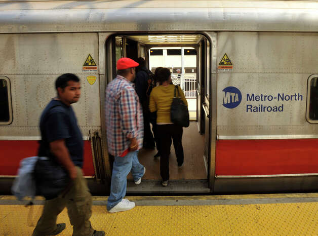 Commuters board the South Norwalk-bound train at the Metro-North station in Stamford on Monday, May 20, 2013. Because of the train derailment in Bridgeport, many travelers were finding the commute to and from New York City difficult. Photo: Jason Rearick / Stamford Advocate