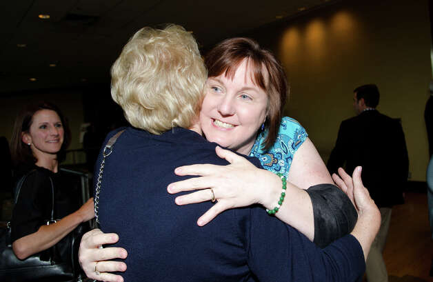 Tricia Gogliettino, of Sandy Hook, hugs Newtown First Selectwoman Pat Llodra during the annual Connecticut GOP Prescott Bush Awards dinner at the Stamford Hilton Hotel in Stamford on Monday, May 20, 2013. Photo: Amy Mortensen / Connecticut Post Freelance