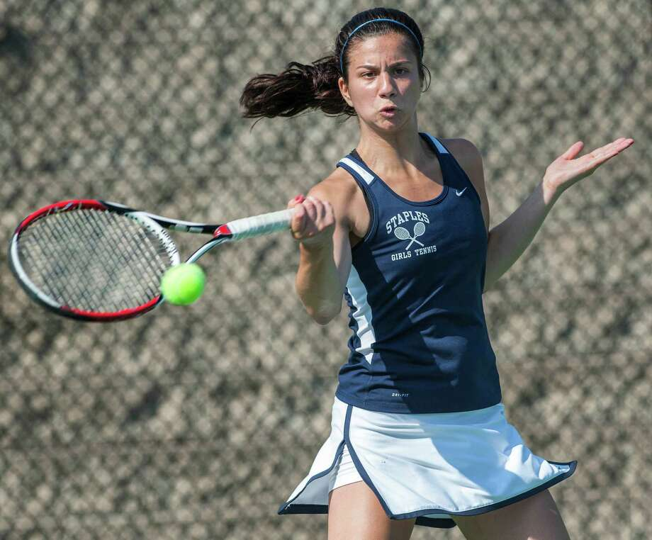 Staples high school's Melissa Beretta returns a shot from Fairfield Ludlowe high school's Lindsey Evans in an FCIAC girls tennis semifinal match played at Fairfield Ludlowe high school, Fairfield, CT on Monday May 20th, 2013. Photo: Mark Conrad / Connecticut Post Freelance
