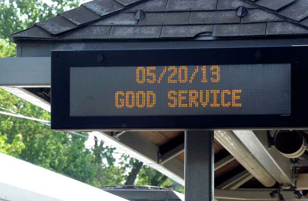 A sign at the Danbury Train Station lets riders know that the trains are running without a problem Monday, May 20, 2013 in Danbury, Conn. Photo: Carol Kaliff / The News-Times