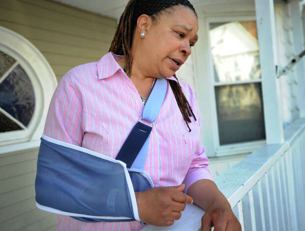 "Cynthia Clarke, of Bridgeport, Conn., suffered a broken shoulder during Friday's Metro North train derailment and collision. Clarke described the sound of the crash as the loudest sound she had ever heard, after which she ""just went flying"". Clarke, a mail carrier, plans to return to work when her shoulder heals. Photo: Brian A. Pounds / Connecticut Post"