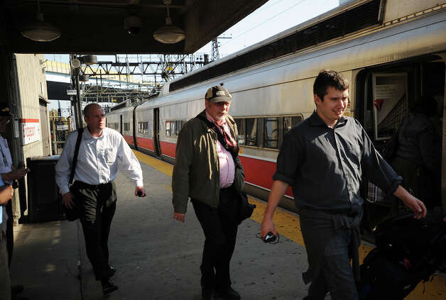 Passengers board a New Haven bound train at the Bridgeport train station in Bridgeport, Conn. on Monday, May 20, 2013. Train service is currently suspended between Bridgeport and South Norwalk due to damage caused by Friday's Metro North train derailment and collision. Photo: Brian A. Pounds / Connecticut Post