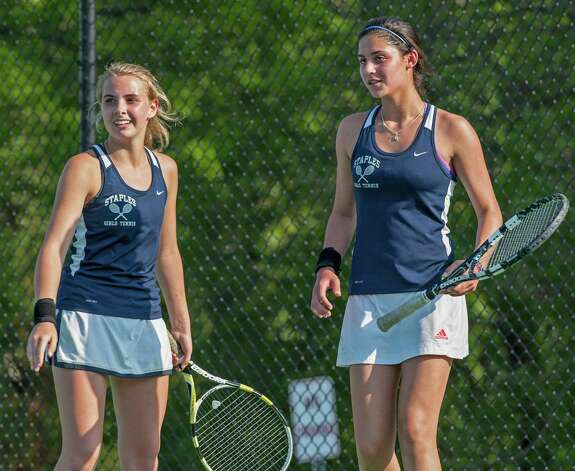 left to right; Staples high school's doubles team Alex Collins and Callie Bartimer during their FCIAC girls tennis semifinal match against Fairfield Ludlowe high school's Colleen Fitzpatrick and Sarah Boyle played at Fairfield Ludlowe high school, Fairfield, CT on Monday May 20th, 2013. Photo: Mark Conrad / Connecticut Post Freelance