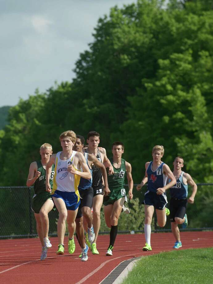 Jake Feinstein from Newtown High School leads the pack down the back straight during the boys 1600 meter run at the South West Conference boys and girls track and field championships held at Bethel High School, Bethel, Conn. Monday May 20, 2013. Photo: H John Voorhees III